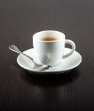 Cup of Coffee on Saucer with Silver Spoon Royalty Free Stock Images