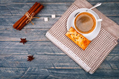 Cup of coffee on saucer with spoon. Vanilla sticks. Star anise and gray napkin Stock Image