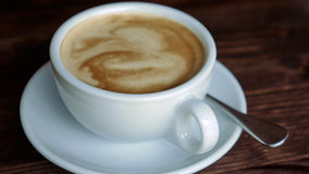Cup with coffee, saucer and teaspoon Stock Image