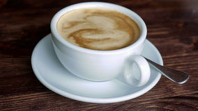 Cup with coffee, saucer and teaspoon Stock Photos