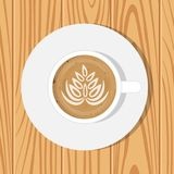 Cup of Coffee and saucer, top view, on realistic wooden surface. Vector illustration. Cappuccino with drawing on foam surface. stock photography