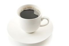 Cup of coffee with saucer on white Royalty Free Stock Image