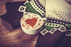 Cup with coffee and scarf. Stock Photos