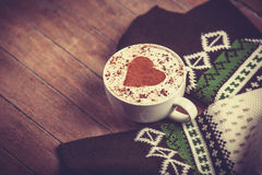Cup with coffee and scarf. Royalty Free Stock Image