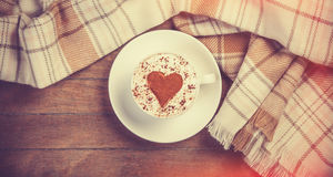 Cup with coffee and scarf. Stock Image