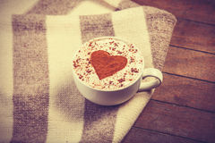 Cup with coffee and scarf. Royalty Free Stock Photos