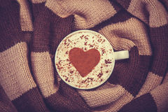 Cup with coffee and scarf. Stock Photography