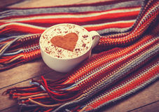 Cup with coffee and scarf. Royalty Free Stock Photo