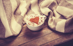 Cup with coffee and scarf. Stock Images