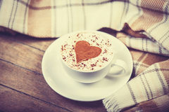 Cup with coffee and scarf. Royalty Free Stock Photography