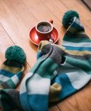 A cup of coffee with a scarf. Stock Photos