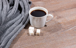 Cup of coffee and a scarf Royalty Free Stock Photo