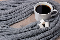 Cup of coffee and a scarf Royalty Free Stock Images