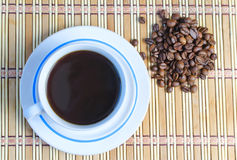 Cup of coffee. And the scattered coffee beans Stock Photography