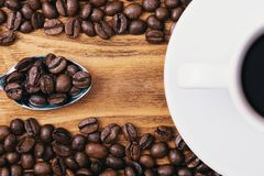 A cup of coffee and scattered coffee beans. Layout. Flat lay. Coffee bean.  stock images