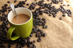 Cup of coffee with scattered coffee beans - Series 2 Stock Photography