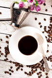 Cup of coffee and scattered coffee Stock Photos