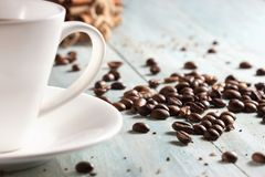 Coffee cup with coffee beans on wooden boards close-up Stock Photos