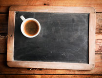 Cup of coffee on a school slate Stock Photography