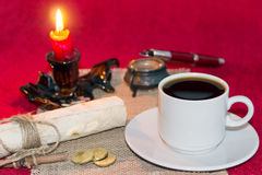Cup of coffee. Cup coffee scroll letter coins candle candle holder fountain pen ink napkin red background white mug black Stock Image