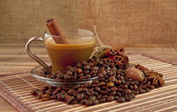 Cup of coffee and seasoning Royalty Free Stock Image
