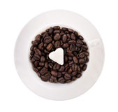Cup of coffee seeds Stock Photos