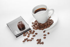 A cup of coffee, seeds, candy and cards Stock Photos