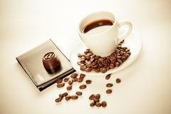 A cup of coffee, seeds, candy and cards Royalty Free Stock Photo