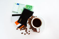 A cup of coffee,  seeds, candy and money Royalty Free Stock Photos