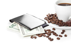 A cup of coffee, seeds, candy and money Stock Photo