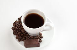 A cup of coffee, seeds, candy Royalty Free Stock Photo