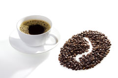 A cup of coffee with seeds and coffee symbol stock photo