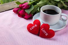 Cup of coffee, shape heart text love and rose Royalty Free Stock Photos