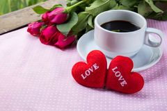 Cup of coffee, shape heart text love and rose Stock Photos
