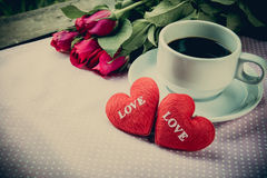 Cup of coffee, shape heart text love and rose Stock Images