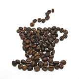 Cup of coffee shape made with coffee beans Royalty Free Stock Images