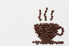 A cup of coffee. Coffee cup shaped coffee beans royalty free stock image