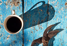 Cup coffee with shears in spring garden Stock Images