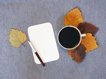 Cup of coffee and sheet of paper Royalty Free Stock Images