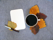 Cup of coffee and sheet of paper Royalty Free Stock Image