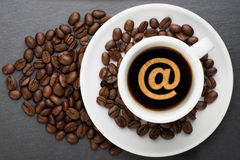 Cup of coffee with at sign Stock Photo