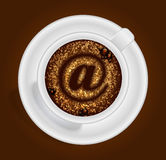 Cup of coffee with the sign Stock Photography