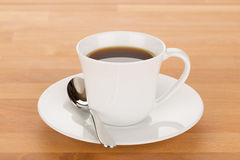 Cup of coffee and silver spoon Stock Photo