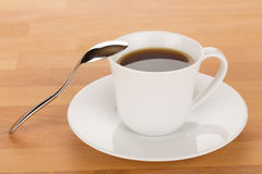 Cup of coffee and silver spoon Royalty Free Stock Photos