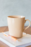 Cup of coffee on simply work table Stock Photos