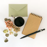 Cup of coffee, sketchbook, pencil and dried flowers. Flat lay, top view Royalty Free Stock Photos