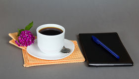 Cup of coffee with sketchpad and the ball-point Royalty Free Stock Images