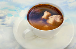Cup of coffee with sky clouds Royalty Free Stock Image