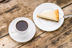 Cup of coffee with slice of cheesecake on cake server Royalty Free Stock Photography