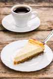 Cup of coffee with slice of cheesecake Stock Photography